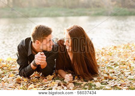 Young Couple Lying Down Talking