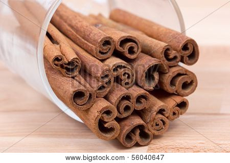 Cinnamon sticks on a wood plateau