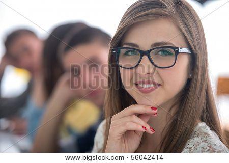Portrait of a smiling schoolgirl in schoolroom