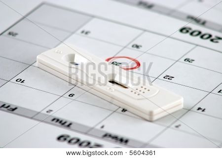 Pregnancy Test And A Circled Date - Close Up