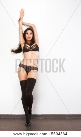Young Chinese Woman Fashion Model In Black Lingerie