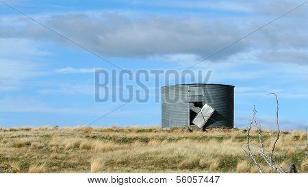 Grain Silo in Rural Field