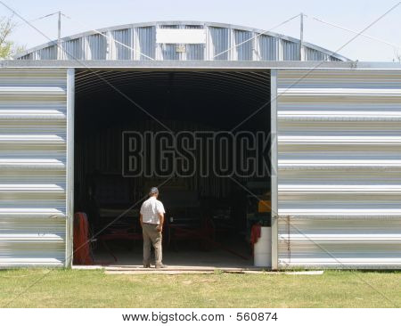 Man And Metal Building