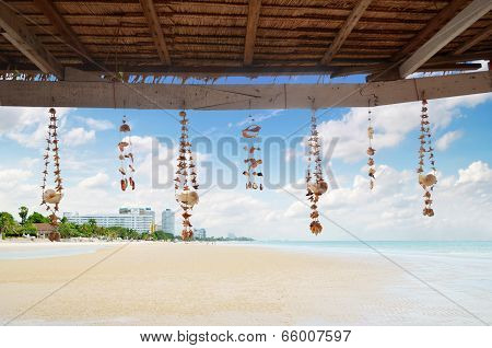Seashell Decoration String Under The Roof On Beach Background