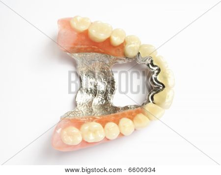 Artificial Teeth On White Background. False Teeth (denture, Crown, Bridge)