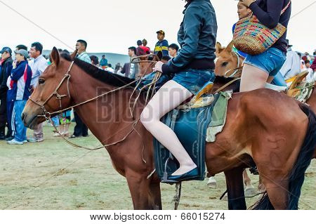 Horseback Girls In Shorts At Nadaam Horse Race