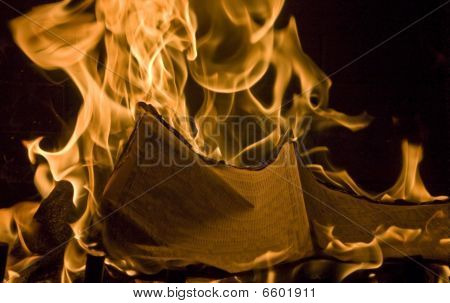 Flames Of Fire Burning Financial Newspaper