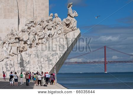 LISBON, PORTUGAL - MAY 28, 2014: Tourist visiting the Monument to the Discoveries in Lisbon. The monument celebrates the Portuguese Age of Discovery during the 15th and 16th centuries.