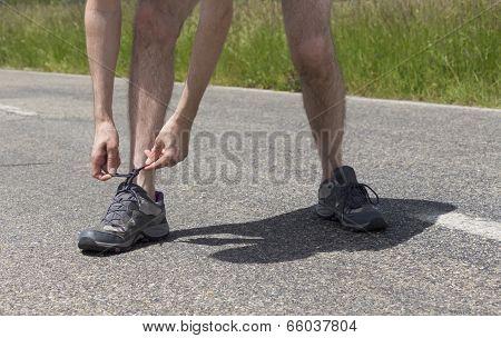 Runner Man Binding The Shoe Laces