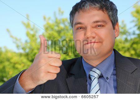Businessman Outdoor In Summer With Ok Gesture