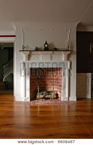 Colonial Style Home Interior Parlor With Brick And Marble Fireplace