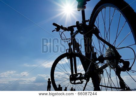 Silhouette Of A Bicycle Against Blue Sky