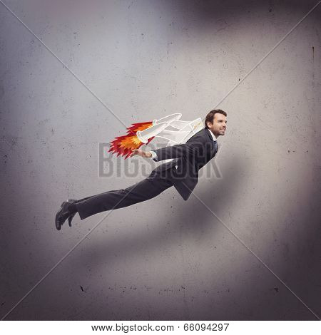 Businessman flying with rocket backpack