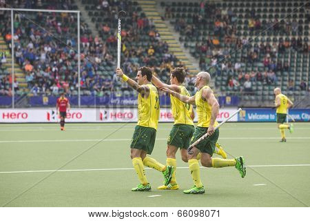 THE HAGUE, NETHERLANDS - JUNE 2: Australian players Govers, Gohades and Hammond celebrating a goal during the Hockey World Cup 2014 in the match between Australia and Spain (men). AUS beats SPA 3-0