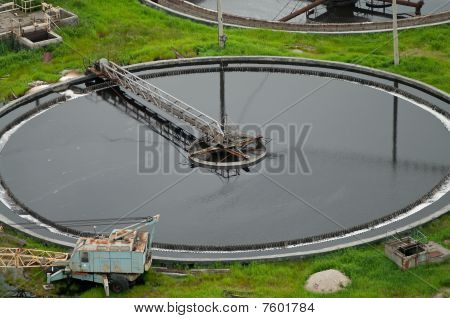 Big sedimentation drainage round form. Water settling purification in the tank by biological organisms on the water station. poster