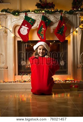 Little Girl Sitting In Big Red Bag For Gifts At Christmas Eve