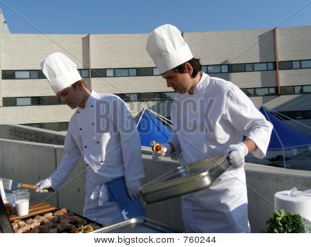 Two chefs working hard