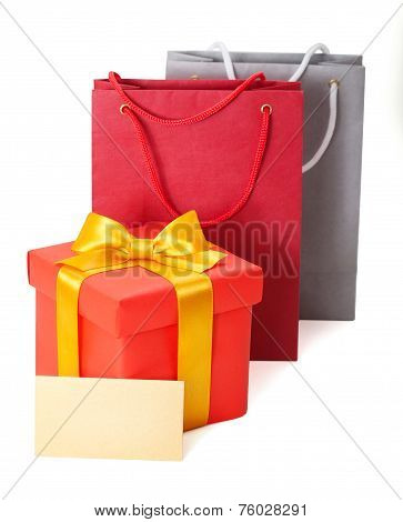 red box with  ribbon and gift card