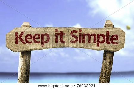 Keep It Simple sign with a beach on background