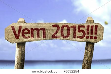 2015 Coming!!! (In Portuguese) sign with a beach on background