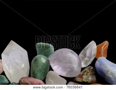 Gemstones margin. Semi-precious gemstones in a glittering rich margin. Quartz point aventurine calcite jadeite and others. poster