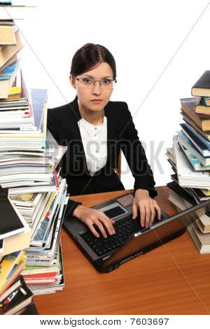 Girl, Computer, And A Lot Of Books