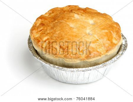 Steak meat pie in foil tray.