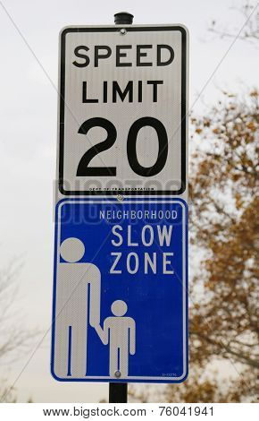 Speed limit 20 and Neighborhood Slow Zone signs