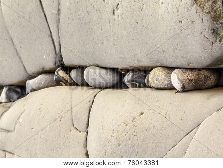 Small Pebbles Stuck In Between Larger Rocks