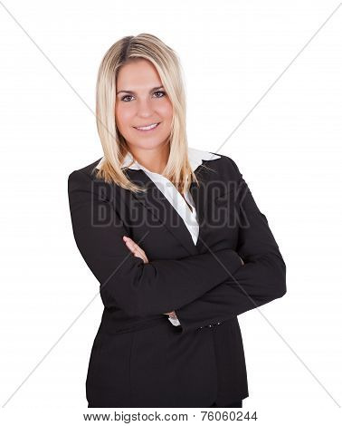 Young businesswoman standing arms crossed