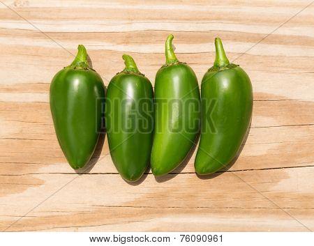 Chile Jalapeno hot chili pepper on wood background