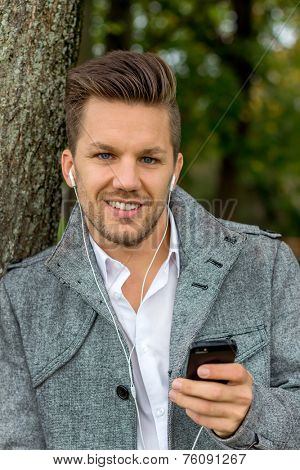 a man listening to music on your mobile phone. talking on the mobile phone.