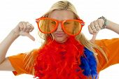 portrait of Dutch soccer fan in orange outfit with big glasses and thumbs down over white background poster