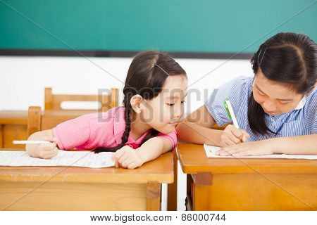 Little Girl Student Trying To Cheat At Test In Class