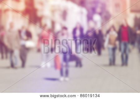Crowd Of People Walking On The Street In Bokeh