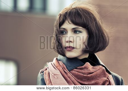 Sad beautiful fashion woman on a city street