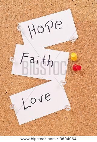 Hope, Faith And Love Cards On Corkboard