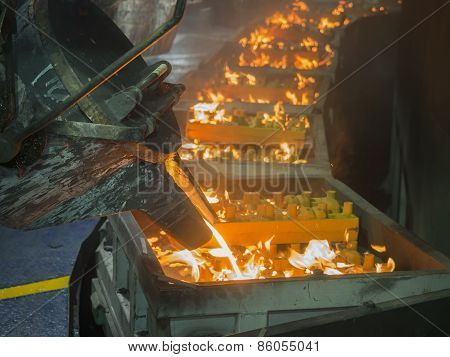 Operator Pouring Moltem Metal In Mold