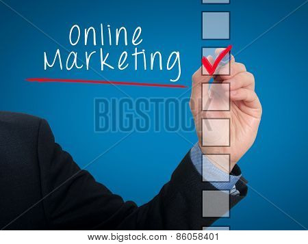 Businessman hand writing online marketing and check listing task. Isolated on background. Sto