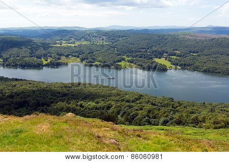 Elevated view of Windermere Lake District England uk from Gummers How with boat sailing in summer