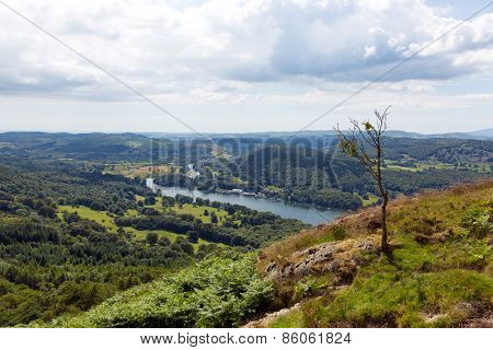 High view of Windermere Lake District England uk from Gummers How with boat sailing in summer