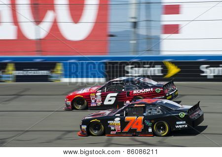 Fontana, CA - Mar 21, 2015:  Darrell Wallace Jr (6) and Mike Harmon (74) battle for position during the Drive4Clots.com 300 race at the Auto Club Speedway in Fontana, CA.