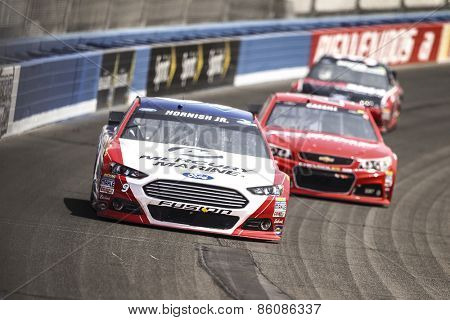 Fontana, CA - Mar 22, 2015:  Sam Hornish Jr. (9) brings his race car through the turns during the  race at the Auto Club Speedway in Fontana, CA.