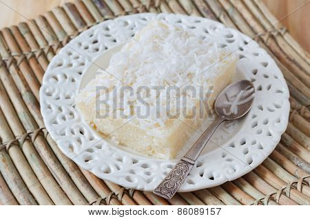 Sweet Couscous Pudding  With Coconut On White Plate With Spoon