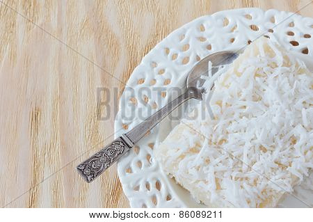 Sweet Couscous Pudding  With Coconut On White Vintage Plate With Spoon
