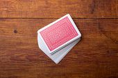 deck of cards on wooden table poster