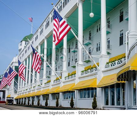American flags fly in front of the famous Grand Hotel