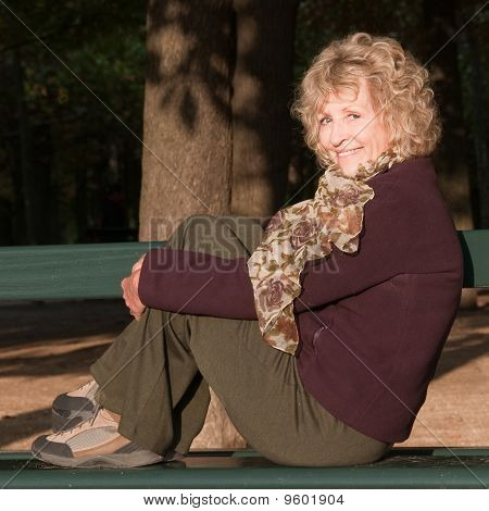 Smiling Woman on Park Bench