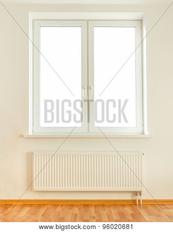 White plastic double window with radiator under it poster