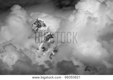 Mountain Peak In The Sky With Clouds.